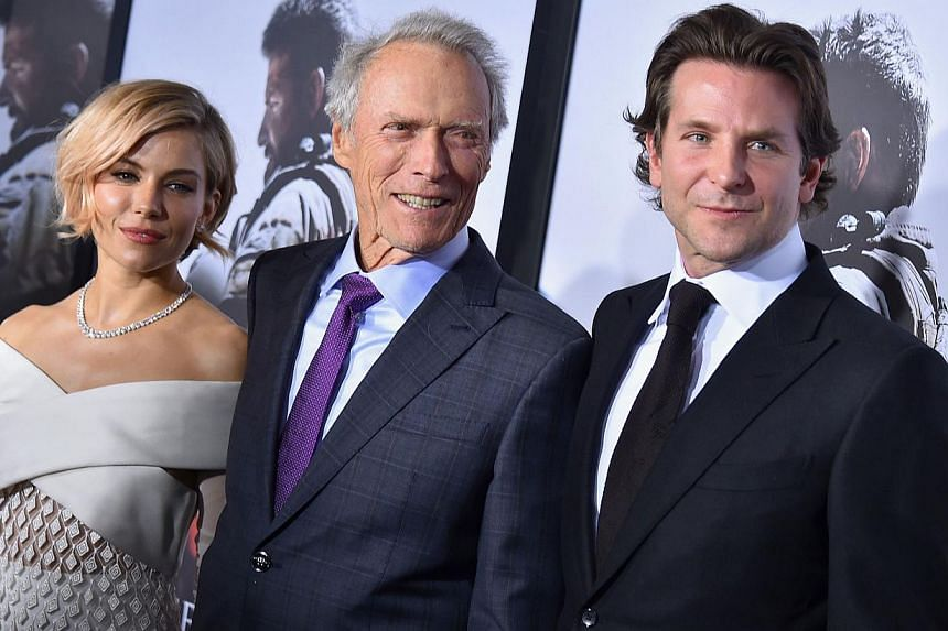 (From left) Sienna Miller, Clint Eastwood and Bradley Cooper arrive at the American Sniper New York Premiere at Frederick P. Rose Hall, Jazz at Lincoln Center in New York City on Dec 15, 2014. -- PHOTO: AFP