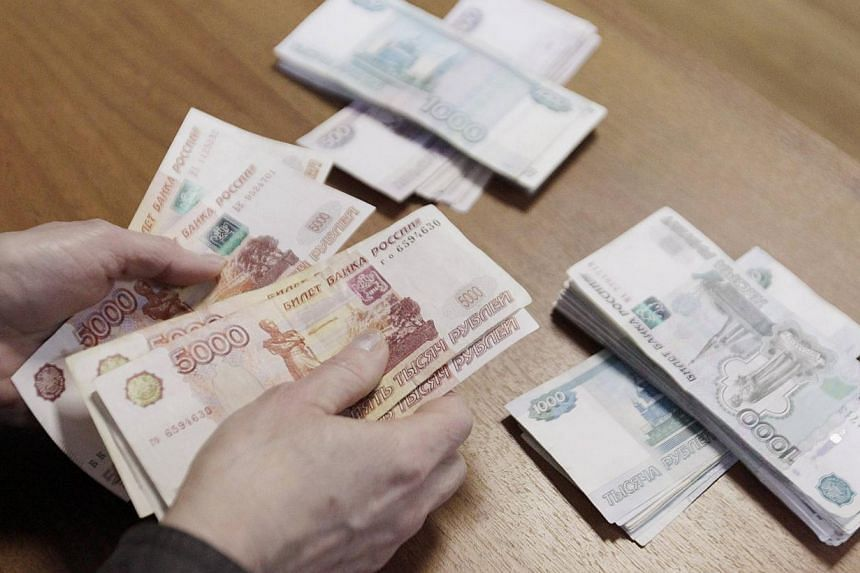 Russia says its currency crisis is over even though its forex reserves have plunged and annual inflation has climbed above 10 per cent. -- PHOTO: REUTERS