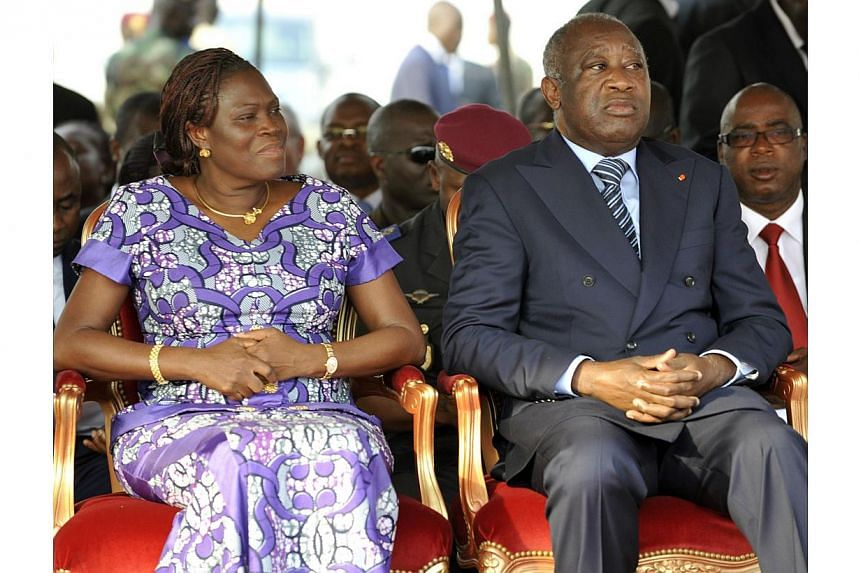 This file picture dated on Feb 4, 2011 shows former Ivory Coast President Laurent Gbagbo (right) and his wife Simone attending a ceremony, in Abidjan, to pay tribute to thirty-two members of the National Armed Forces of Ivory Coast (FANCI) that lost