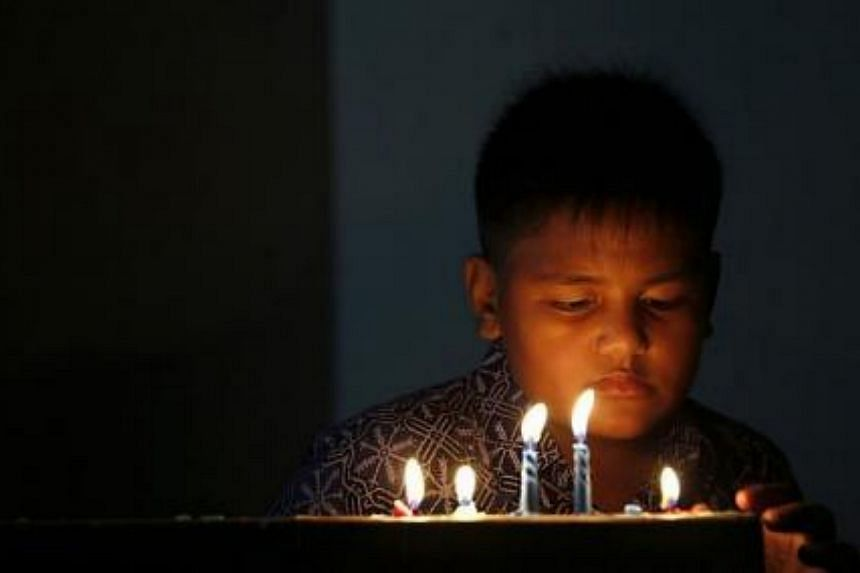 A child attends a mass during Christmas eve at HKBP church in Banda Aceh, on Dec 24, 2014. -- PHOTO: REUTERS