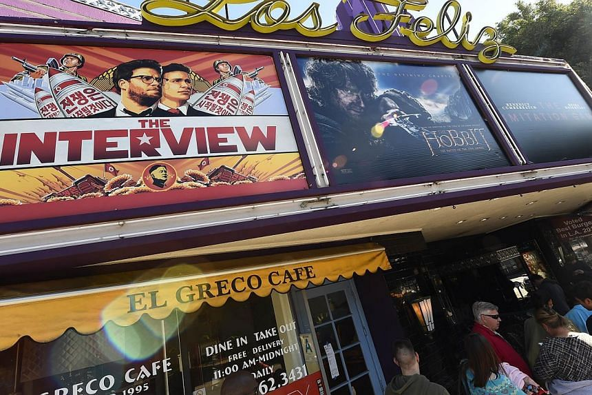 Movie-goers wait in line outside the Los Feliz 3 Cinema in Los Angeles, California Dec 25, 2014 to by tickets for the The Interview. -- PHOTO: AFP