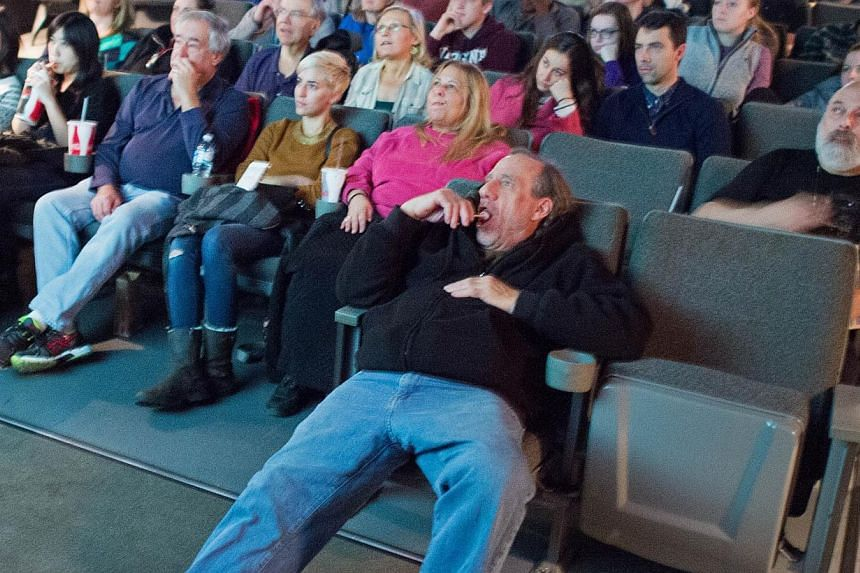 Movie goers watching coming attractions moments before The Interview at West End Cinema on Dec 25, 2014, in Washington, DC. -- PHOTO: AFP