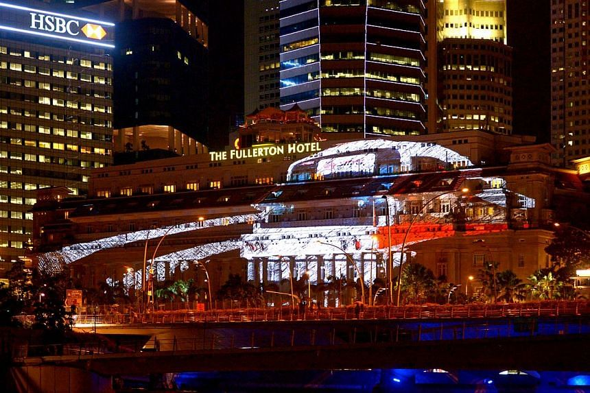 3D projection mapping display of a MRT train on the facade of Fullerton Hotel Singapore on Dec 26, 2014. -- ST PHOTO: LIM SIN THAI