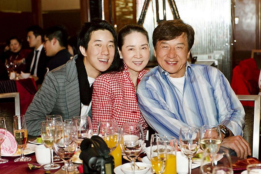 Jaycee Chan (left) with his parents, former actress Lin Feng-jiao (centre) and action star Jackie Chan, in 2012 at Lin's 60th birthday party. -- PHOTO: ONE HOUSE