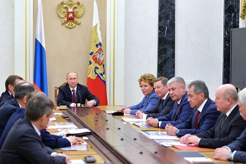Russian President Vladimir Putin (middle) chairs a Security Council meeting at the Kremlin in Moscow on Dec 26, 2014. -- PHOTO: AFP