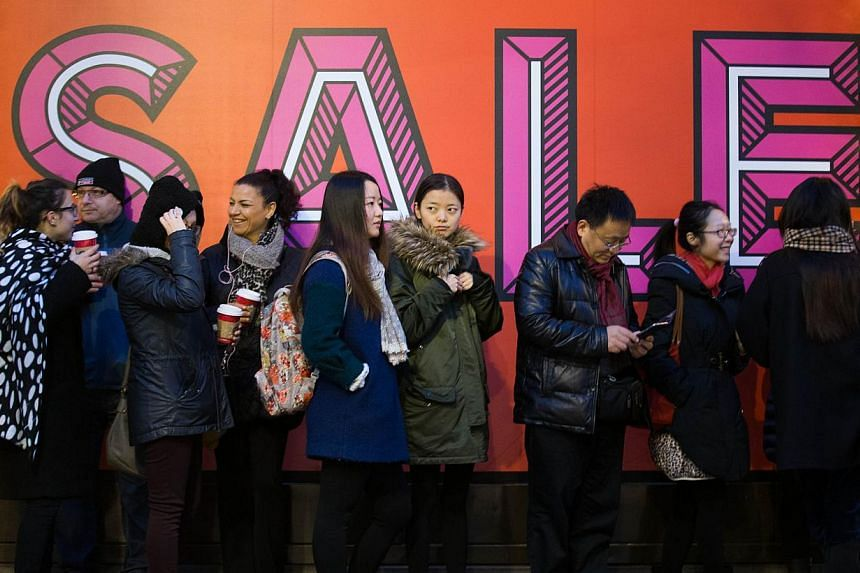 Shoppers queue outside Selfridges department store before it opens in central London, on Dec 26, 2014, for the post-Christmas, Boxing Day sales. -- PHOTO: AFP