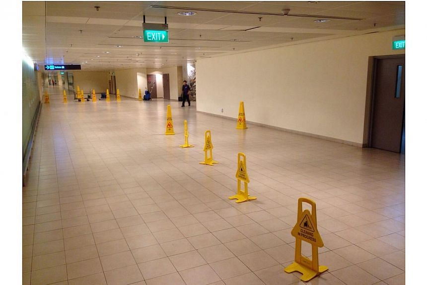 The wet floor on the second level of Terminal Two. -- PHOTO: RONALD SNG