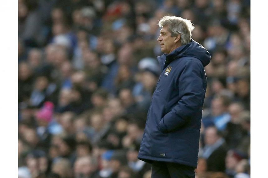 Manchester City manager Manuel Pellegrini reacts during their English Premier League soccer match against Crystal Palace at the Etihad Stadium in Manchester, northern England on Dec 20, 2014. -- PHOTO:REUTERS
