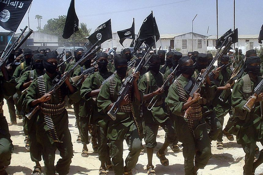 A file photo taken on Feb 17, 2011 shows Islamist fighters loyal to Somalia's Al-Qaedainspired Al-Shebabgroup performing military drills at a village in Lower Shabelle region, some 25 kilometres outside Mogadishu. -- PHOTO: AFP