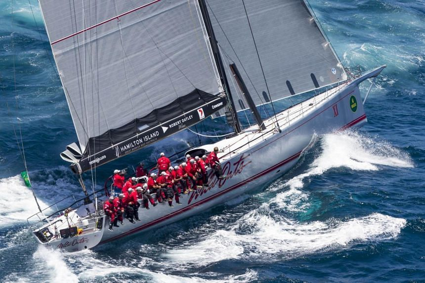 In this handout photo released by Rolex on Dec 27, 2014, Australian yacht Wild Oats XI sails in the Sydney to Hobart yacht race. -- PHOTO: AFP