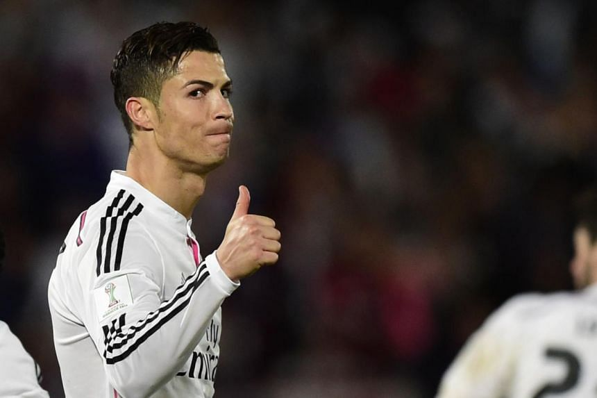 Real Madrid's Portuguese forward Cristiano Ronaldo gives the thumbs up during the FIFA Club World Cup final football match against San Lorenzo at the Marrakesh stadium in the Moroccan city of Marrakesh on Dec 20, 2014. Not content with four titles in