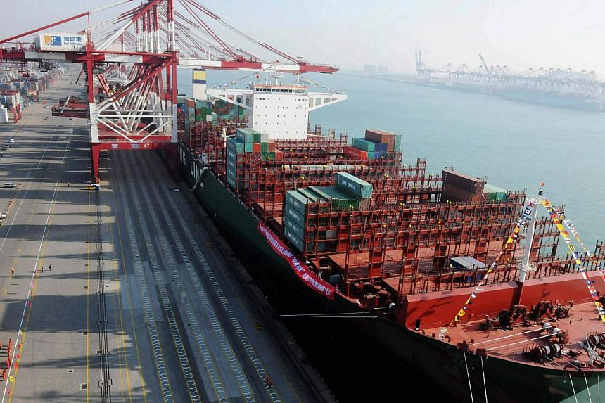 This picture taken on December 4, 2014 shows the China Shipping Container Lines Co.Ltd (CSCL) Globe berthing in Qingdao port during its maiden voyage to Europe in Qingdao, east China's Shandong province.PHOTO: AFP