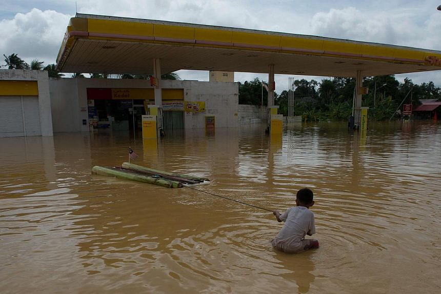 Kelantan (above) has been hit the hardest by the floods. Other states badly affected are Pahang, Terengganu and Perak. The southern state of Johor is the latest to be affected and flash floods have also hit Kuala Lumpur. At least five people have bee