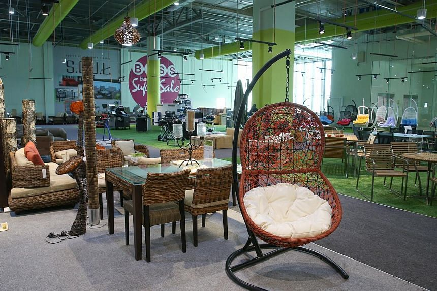 Jumbo freezers in the frozen food section and the third floor displays furniture set up according to themes, such as outdoor furniture (above). -- ST PHOTO: ONG WEE JIN
