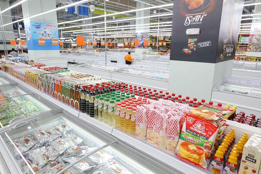 Jumbo freezers (above) in the frozen food section and the third floor displays furniture set up according to themes, such as outdoor furniture. -- ST PHOTO: ONG WEE JIN