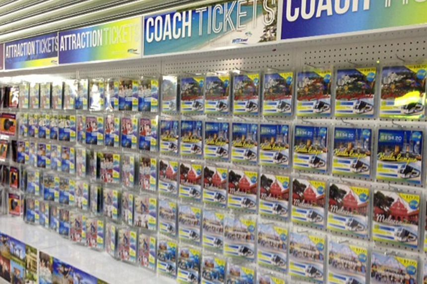Shoppers can pick up coupons (above) such as for bus rides to Malaysia and entrance passes to attractions, while the Silver Box offers geriatric products such as walking sticks and wheelchairs. -- ST PHOTO: NATASHA ANN ZACHARIAH