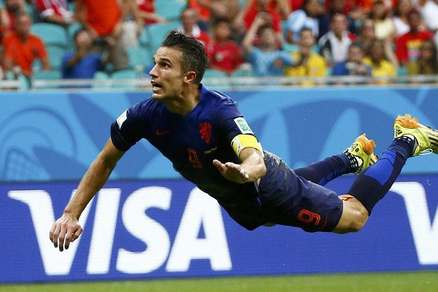 Robin van Persie's diving-header goal for Netherlands in their 5-1 win against Spain has become one of the iconic images of the 2014 World Cup in Brazil. -- PHOTO: ACTION IMAGES