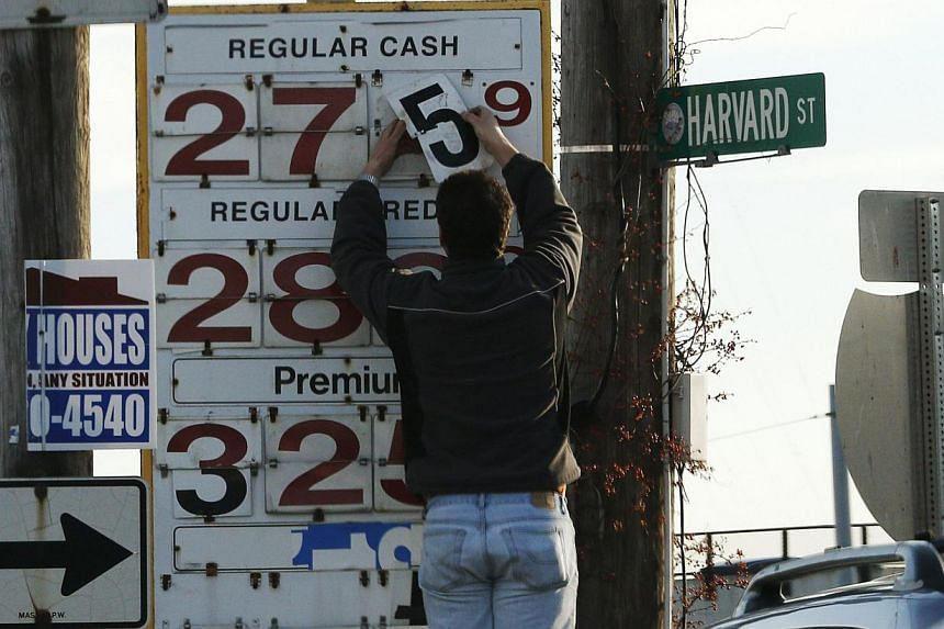 The price of petrol gets an update at a station in Medford, Massachusetts, early this month. Two big factors driving the price of oil are the exploitation of shale oil and gas in the United States, and the shift in China's economic focus from one o