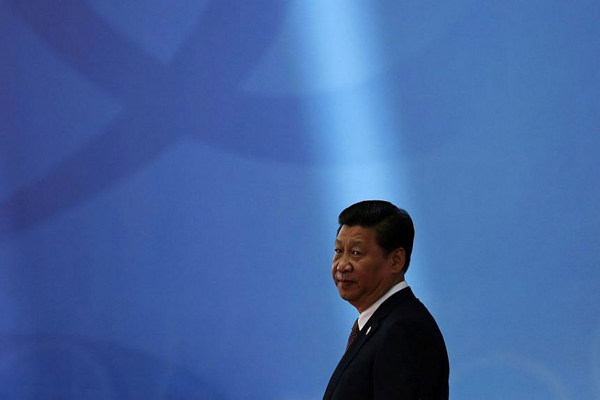 China is shifting away from muscle-flexing in the region towards a new and more emollient diplomacy. A key part of its charm offensive is its effort to improve relations with Japan, initiated at a meeting between Chinese President Xi Jinping (above)
