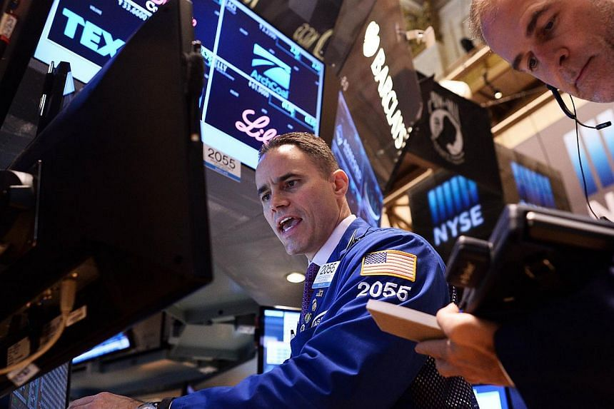 Wall Street stocks rose to fresh records Friday, as investors savored an outstanding US GDP report released earlier this week. -- PHOTO: AFP