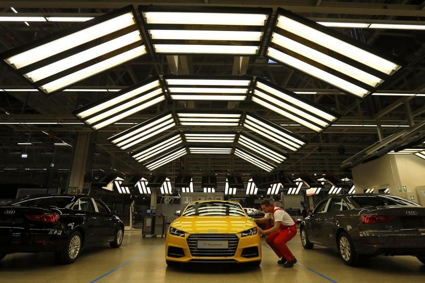 A factory worker polishes the new Audi TT roadster on the assembly line as serial production of the new roadster starts at the Audi plant in Gyor, west of Budapest on Nov 5, 2014. -- PHOTO: REUTERS