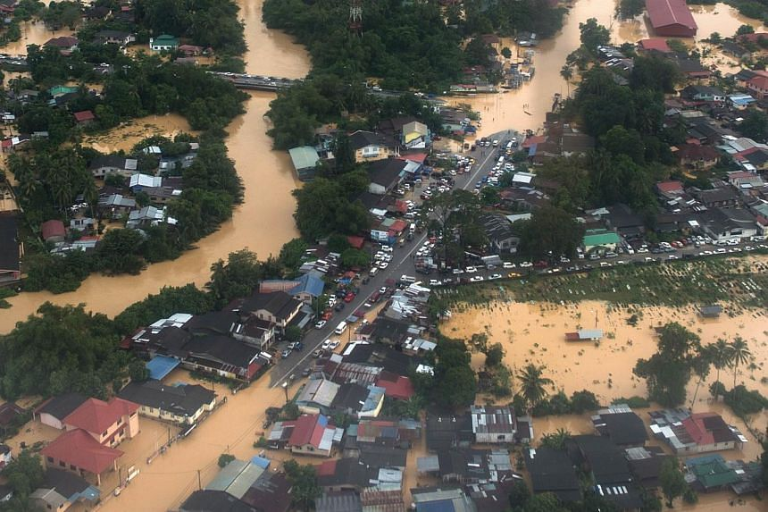 This aerial view shows houses submerged in floodwaters in Pengkalan Chepa, near Kota Bharu on Dec 27, 2014. -- PHOTO: AFP