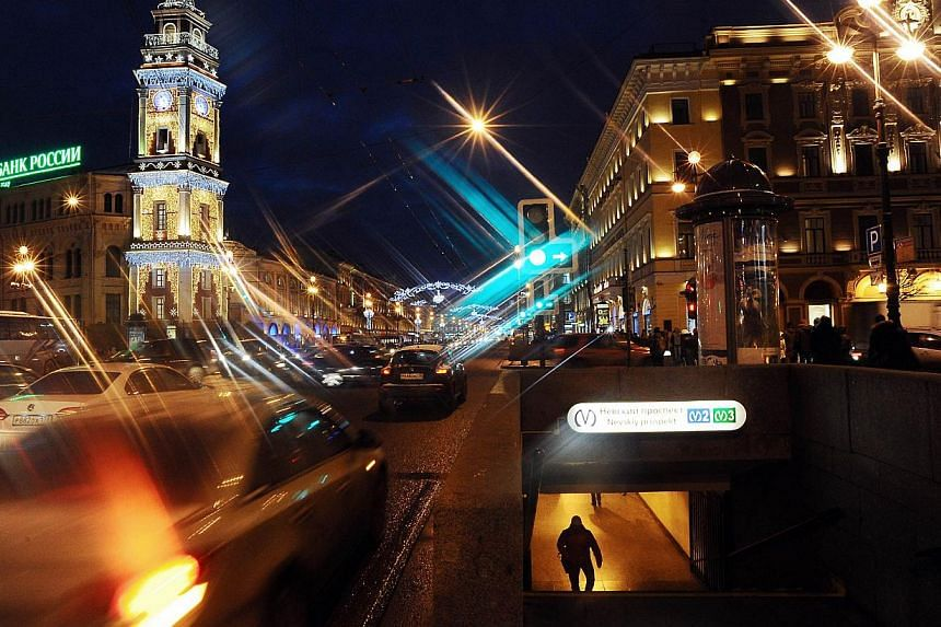 Nevsky Prospect is illuminated for Christmas and New Year celebrations in Saint Petersburg on Dec 23, 2014. The city has imposed rationing on metro tickets after people started panic-buying them ahead of a New Year price rise. -- PHOTO: AFP