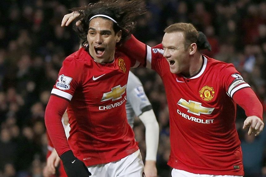 Manchester United's Wayne Rooney (right) celebrates after scoring a goal with team-mate Radamel Falcao during their English Premier League soccer match at Old Trafford in Manchester, northern England Dec 26, 2014. -- PHOTO: REUTERS