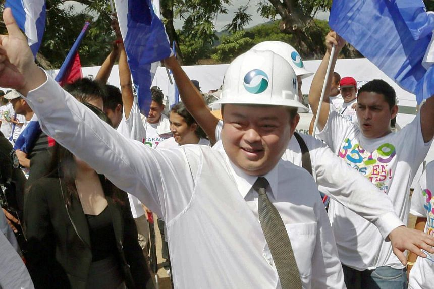 Chinese businessman Wang Jing of HKND Group gives the thumbs up during the inauguration of works on an inter-oceanic canal in Tola, some 3km from Rivas, Nicaragua, on Dec 22, 2014. -- PHOTO: AFP