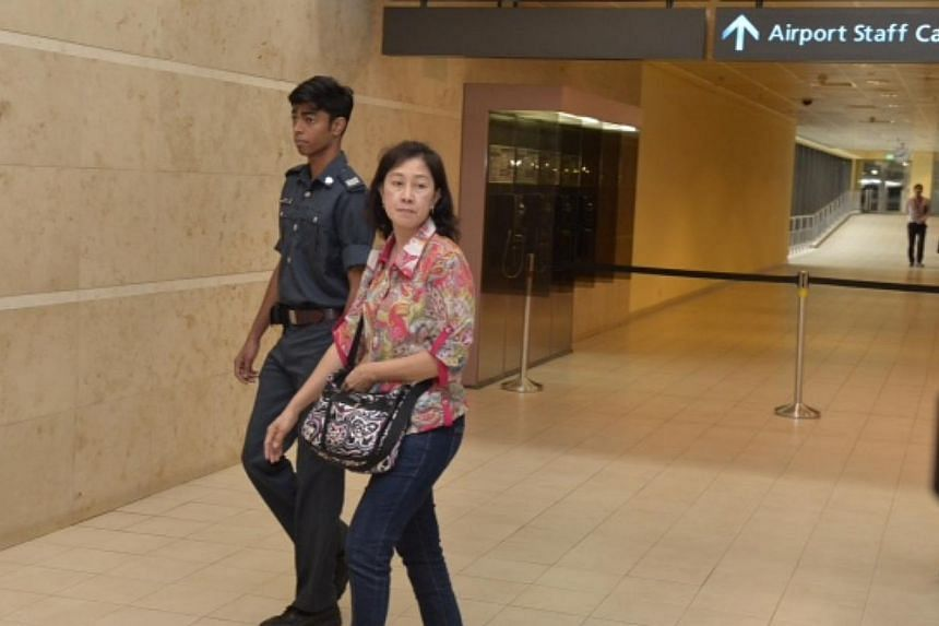 Unidentified next of kin entering the holding area at Changi Airport  terminal 2 for relatives of the missing Air Asia flight on the 28 Dec 2014. -- ST PHOTO: DESMOND FOO