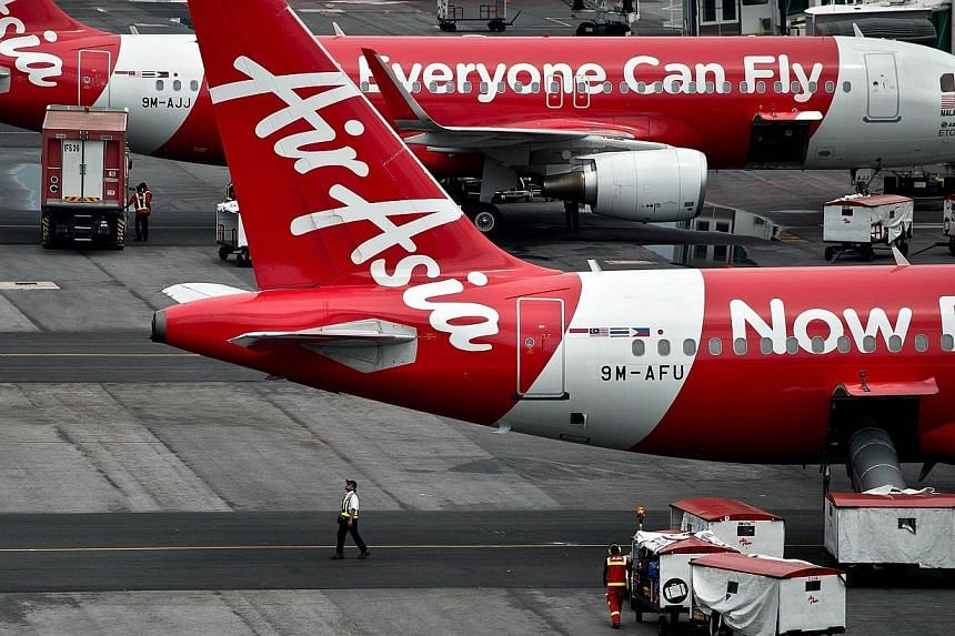 "An AirAsia flight en route to Pulau Langkawi had to turn back due to ""technical issues"" some 10 minutes after taking off from Penang on Sunday afternoon. -- PHOTO: AFP"