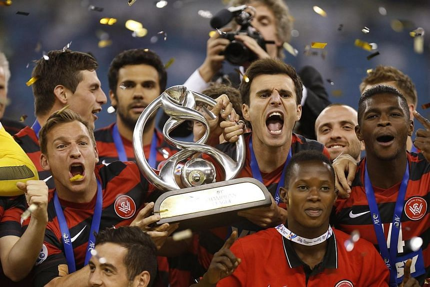 Australia's Western Sydney Wanderers hold the trophy as the celebrate winning their second-leg soccer match of the Asian Champions League final against Saudi Arabia's Al Hilal at King Fahd International Stadium in Riyadh on Nov 1, 2014. The Wanderers
