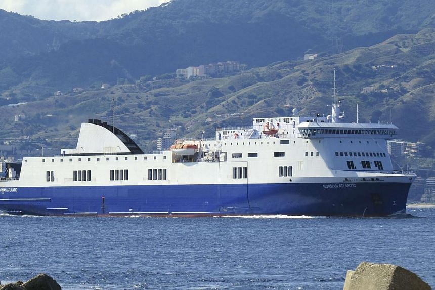 The vessel Norman Atlantic is seen in this photo taken on Sept 26, 2014.Passengers aboard a car ferry that caught fire off the coast of Greece early on Sunday pleaded for help as rescue vessels struggled to approach the burning vessel in high w