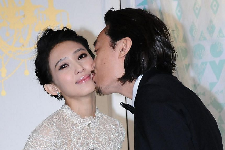 Malaysian singer Penny Tai married Taipei gallery owner Sidney Lu on Saturday at Taipei's Songshan Cultural and Creative Park. -- PHOTO: XINHUA