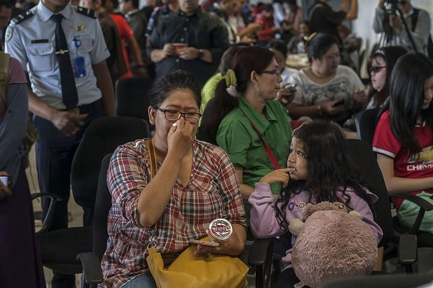 Family members of passengers of missing Malaysian air carrier AirAsia flight QZ8501 gather at Juanda international airport in Surabaya in East Java on Dec 28, 2014 hours after the news the flight went missing. -- PHOTO: AFP