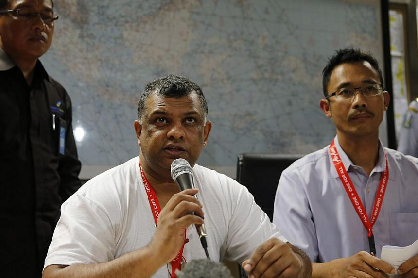 Air Asia CEO Tony Fernandes (left) sits beside Indonesia Air Asia CEO Sunu Widyatmoko (right) as they hold a news conference at Surabaya's Juanda International Airport on Dec 28, 2014. Mr Fernandes described the disappearance of QZ8501 from Surabaya