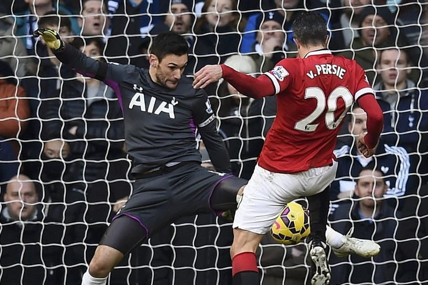 Manchester United's Robin van Persie (right) fails to score past Tottenham Hotspur's Hugo Lloris (left) during their English Premier League soccer match at White Hart Lane in London on Dec 28, 2014. -- PHOTO: REUTERS