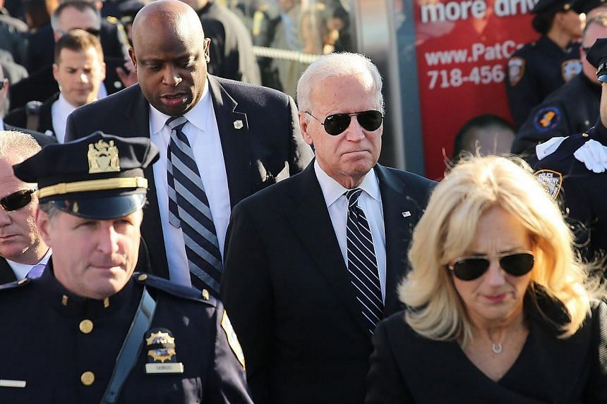 US Vice President Joseph Biden and his wife Jill (right) enter the Christ Tabernacle Church for the funeral of slain New York City police officer Rafael Ramos, one of two officers murdered while sitting in their patrol car in an ambush in Brooklyn la