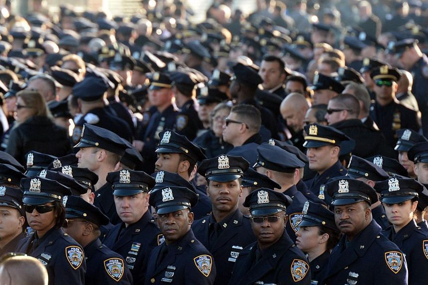Police officers gather for the funeral for New York police officer Rafael Ramos on Dec 27, 2014 in New York. Thousands of people, including US Vice-President Joe Biden, attended the funeral Saturday for Ramos, one of two New York officers shot dead i