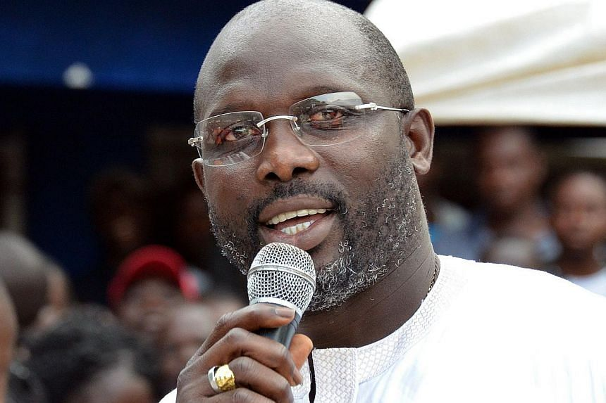 Former world football player of the year George Weah won a seat in Liberia's Senate to represent the capital, defeating the son of the president and boosting his political fortunes ahead of a presidential election in 2017. -- PHOTO: AFP