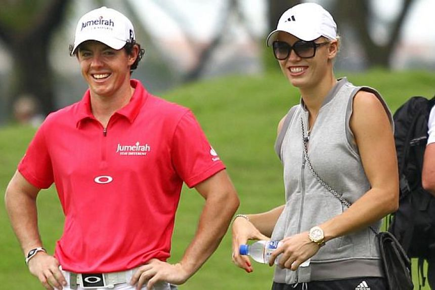 Golfer Rory McIlroy and then girlfriend, tennis player Caroline Wozniacki, at the Sentosa Golf Club in 2012 for the Barclays Singapore Open. -- PHOTO: NEW PAPER