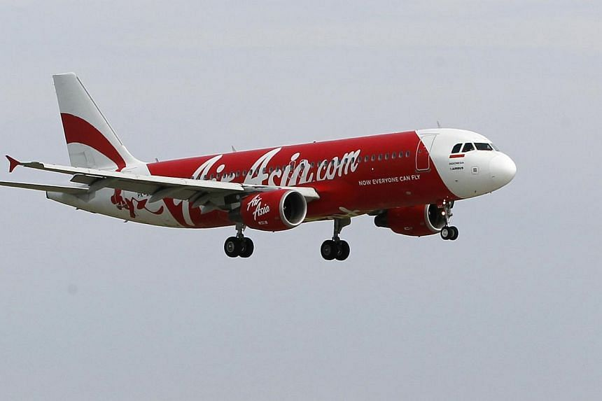 An Indonesia AirAsia Airbus A320-200 passenger preparing to land at Sukarno-Hatta airport in Tangerang on the outskirts of Jakarta in this Jan 30, 2013 file picture. -- PHOTO: REUTERS