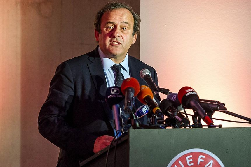 """Uefa president Michel Platini on Sunday reiterated his desire to introduce a """"white card"""" that would lead to a player being sin-binned. -- PHOTO: AFP"""