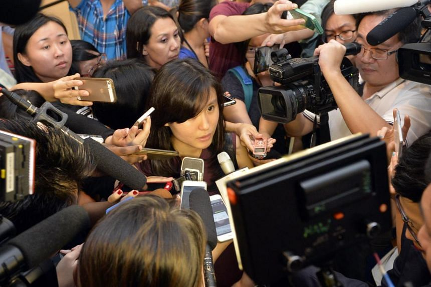 Louise Sidharta, 25, whose fiance Alain was travelling on AirAsia flight QZ8501 with his three brothers and parents, speaking to the media outside the holding room for relatives and next-of-kin at Changi Airport Terminal 2 on Dec 28, 2014. The flight