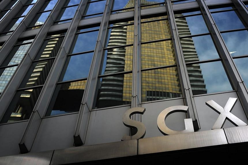 Singapore Exchange announced on Monday it will upgrade its derivatives trading and clearing platforms to improve risk controls, increase efficiency and lower costs for market participants. -- PHOTO: ST FILE