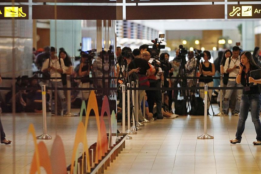 Relatives and next-of-kin of passengers on missing AirAsia flight QZ8501 have begun streaming again at about 8am on Monday morning into the holding area set up for them at Changi Airport's Terminal 2. -- PHOTO: REUTERS