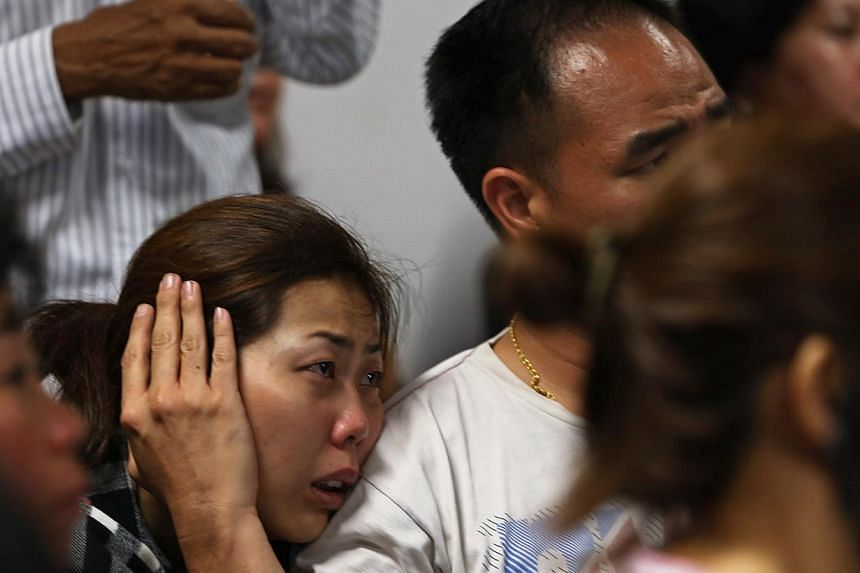 Family of passengers on board AirAsia flight QZ8501 at a waiting area in Juanda International Airport, Surabaya on Dec 28, 2014. -- PHOTO: REUTERS