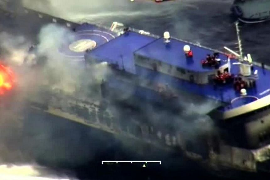 """A photo grab taken from a video made available by the Guardia costiera, Italy's coast guard organisation, on Dec 28, 2014, shows the burning ferry """"Norman Atlantic"""" adrift off Albania. -- PHOTO: AFP"""