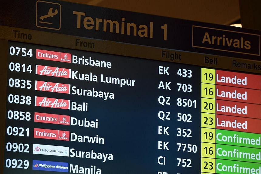 One day after QZ8501 went missing, an AirAsia flight on the same route and carrying the same code from Surabaya to Singapore landed at Changi on Dec 29, 2014. -- ST PHOTO:NG SOR LUAN