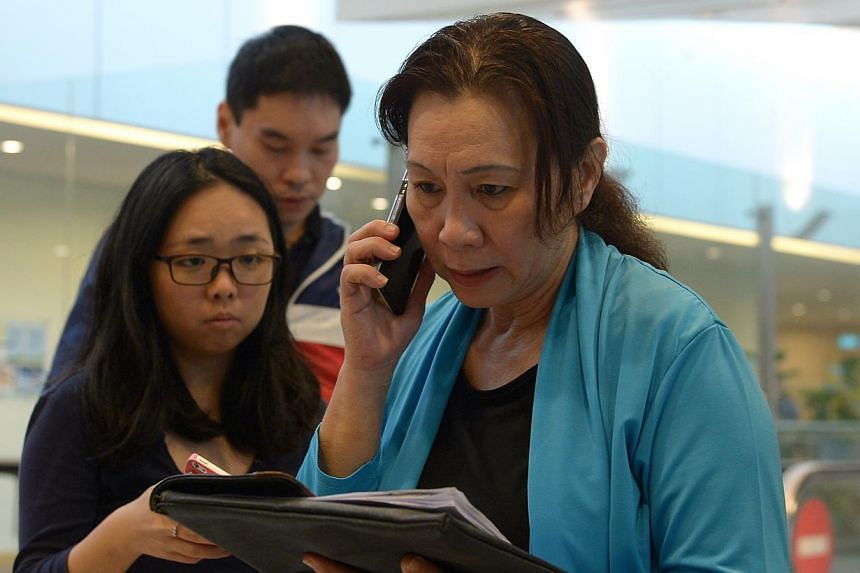 The middle-aged woman who told reporters at Changi Airport that she was Ms Yuni's agent. -- ST PHOTO: NG SOR LUAN